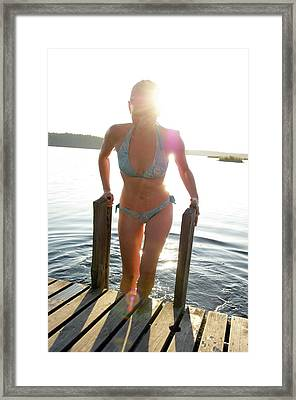 A Young Woman Gets Out Of The Water Framed Print