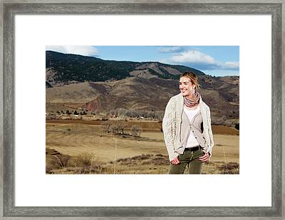 A Young Woman Poses In Layered Outdoor Framed Print
