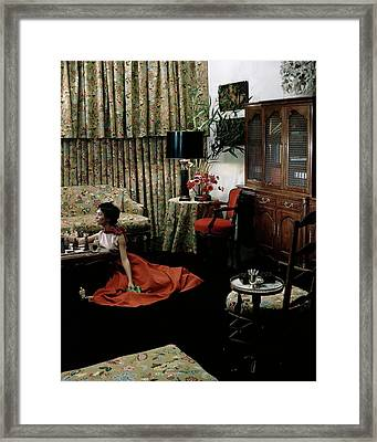 A Young Woman Sitting On The Floor In The Living Framed Print