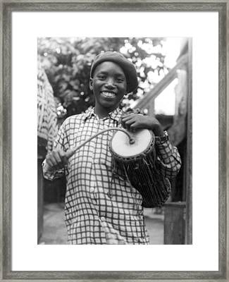 A Young Yoruba Drummer Framed Print by Underwood Archives
