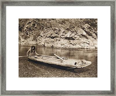 A Yurok In His Dugout Canoe Framed Print by Underwood Archives