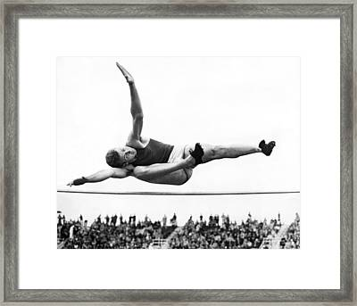 Aaaa Winning High Jump Framed Print by Underwood Archives