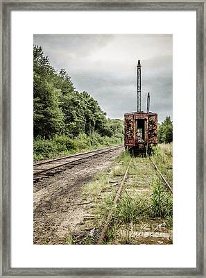 Abandoned Burnt Out Train Cars Framed Print by Edward Fielding