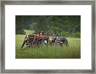 Abandoned Farm Tractor In The Grass Framed Print by Randall Nyhof