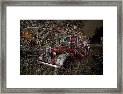 Abandoned Firetruck At Night Framed Print by Tom Phelan