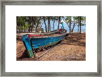 Abandoned Longboat Framed Print by Adrian Evans