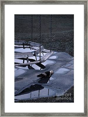 Abandoned Playground With Old Doll Left Behind Framed Print