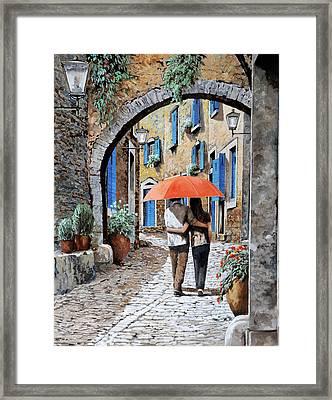 Abbracciati Sotto L'arco Framed Print by Guido Borelli