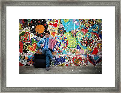 Accordion Player Framed Print by Pedro Nunez