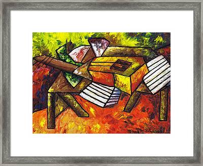 Acoustic Guitar On Artist's Table Framed Print by Kamil Swiatek