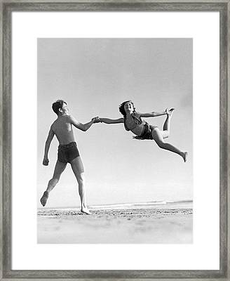 Acrobatic Beach Exhibition Framed Print by Underwood Archives