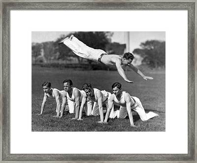 Acrobatic Swandive Framed Print by Underwood Archives