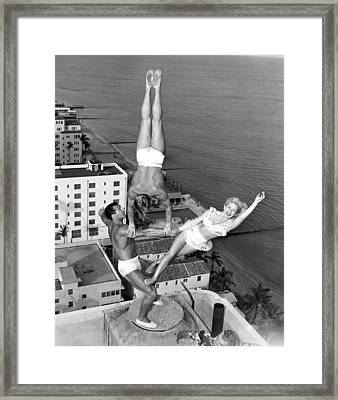 Acrobatic Trio Framed Print by Underwood Archives