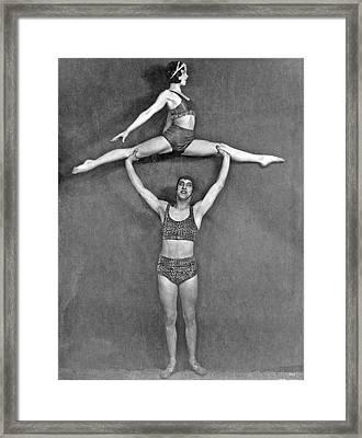 Acrobatic Vaudeville Couple Framed Print by Underwood Archives
