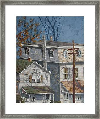 Across The Street Framed Print by Tony Caviston