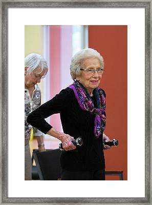 Active Elderly Lady Exercising Framed Print