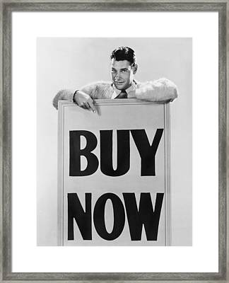 Actor Says buy Now Framed Print