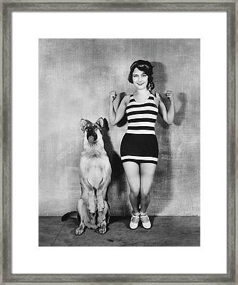 Actress And Dog Exercise Framed Print