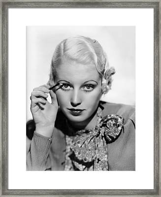 Actress Curls Her Lashes Framed Print by Underwood Archives