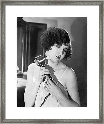 Actress Using Massage Device Framed Print