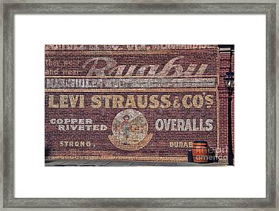 Ad On Brick Framed Print