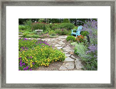 Adirondack Chair And Flowers Framed Print