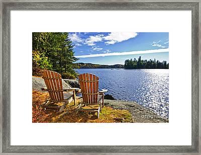 Adirondack Chairs At Lake Shore Framed Print by Elena Elisseeva