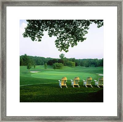Adirondack Chairs In A Golf Course Framed Print