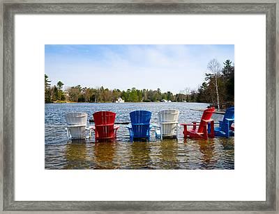 Adirondack Chairs Partially Submerged Framed Print by Panoramic Images