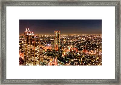 Aerial View Of A City At Night Framed Print by Panoramic Images