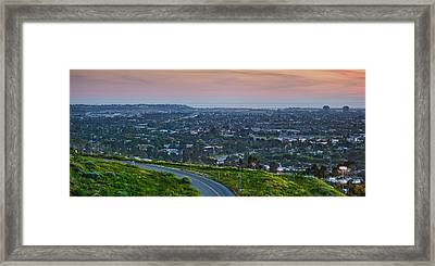 Aerial View Of A City Viewed Framed Print by Panoramic Images