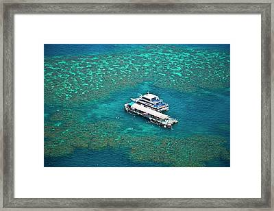 Aerial View Of A Tour Boat Docked Framed Print