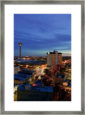 Aerial View Of Buildings Lit Framed Print by Panoramic Images