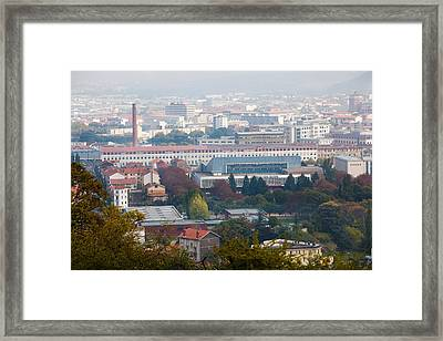 Aerial View Of City And Michelin Tire Framed Print by Panoramic Images