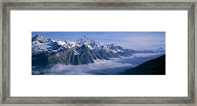 Aerial View Of Clouds Over Mountains Framed Print