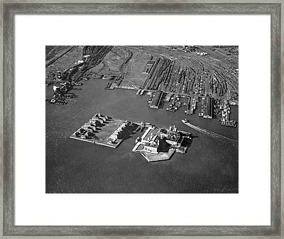 Aerial View Of Ellis Island Framed Print by Underwood Archives