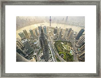 Aerial View Of Skyscrapers In Shanghai Framed Print by Yongyuan Dai