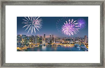 Aerial View Of The Singapore Skyline Framed Print by Franckreporter