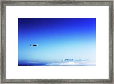 Aeroplane Flying In A Clear Blue Sky Framed Print by Wladimir Bulgar