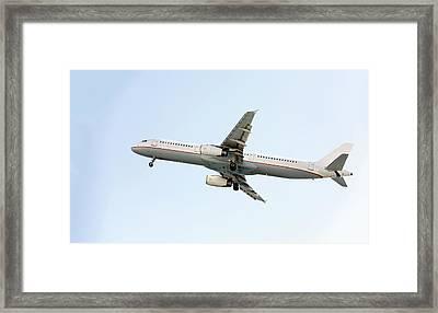 Aeroplane In Sky Framed Print by Wladimir Bulgar