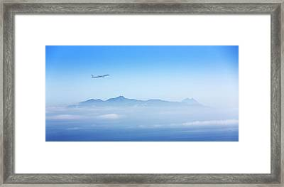 Aeroplane Over Mountains Framed Print by Wladimir Bulgar