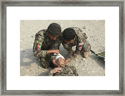 Afghan National Army Soldiers Put Framed Print by Stocktrek Images
