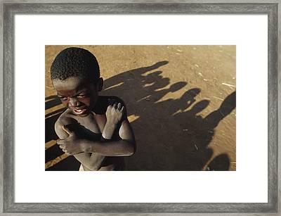 African Boy, Bare-chested, Arms Crossed Framed Print