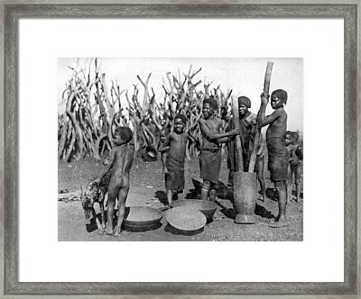 African Girls Grinding Corn Framed Print