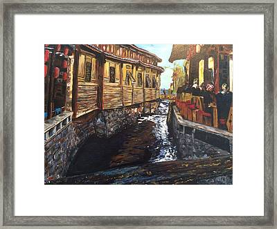 Afternoon Delight In Old Town Of Lijiang Framed Print by Belinda Low