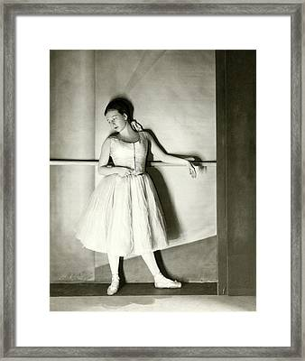 Agnes De Mille Resting Her Arm On A Balance Bar Framed Print by Nickolas Muray