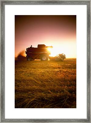 Agriculture - A Combine Harvests Wheat Framed Print by Mirek Weichsel