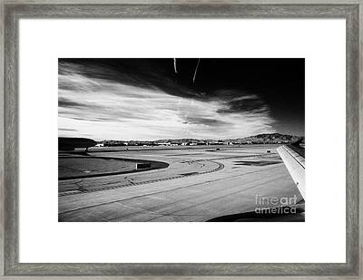 aircraft on runway and taxiway waiting to take off at McCarran International airport Las Vegas Framed Print