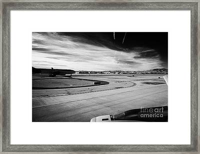 aircraft on runway and taxiway waiting to take off at McCarran International airport Las Vegas Nevad Framed Print
