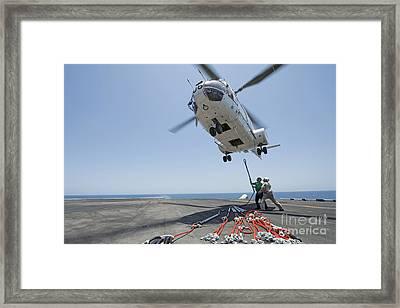 Airmen Attach A Cargo Hook To An Framed Print